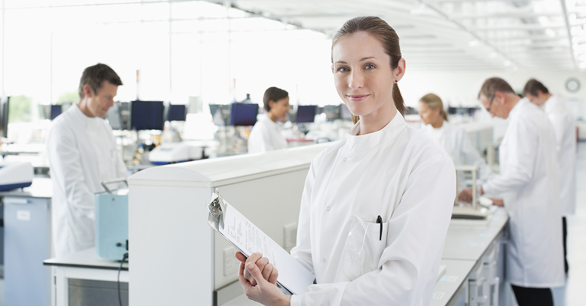Scientist in lab implementing quality control through flow cytometry