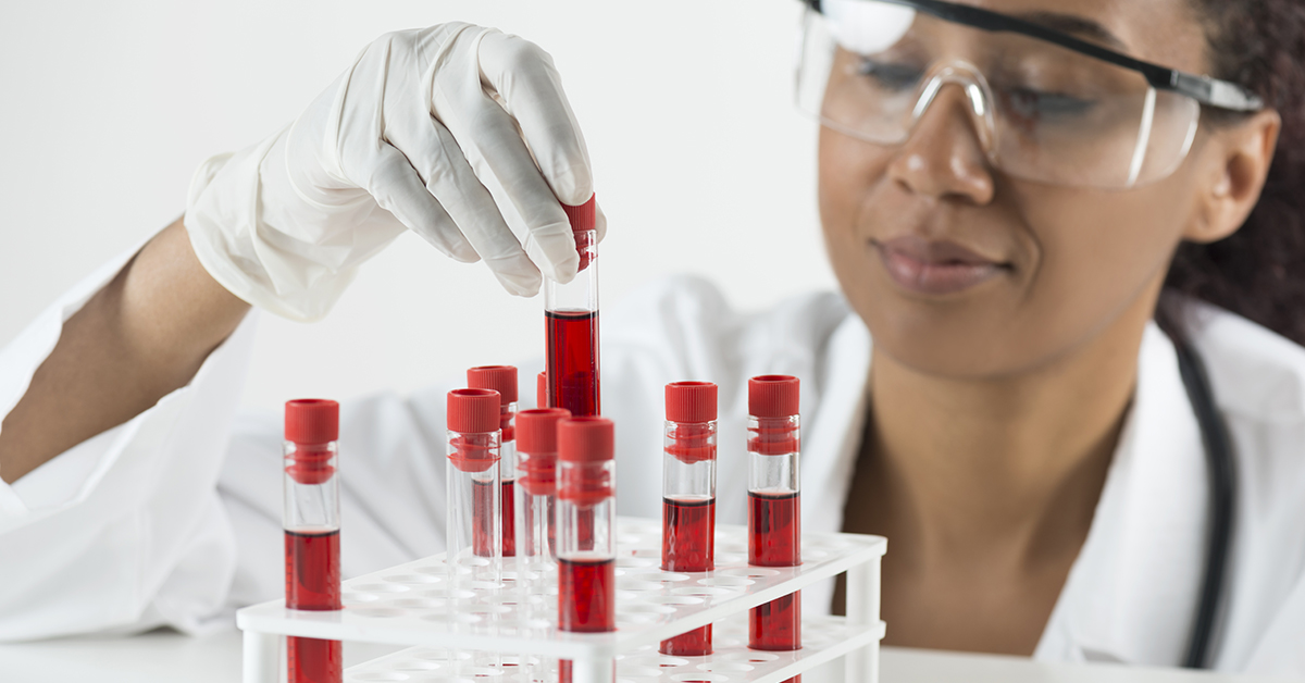 Scientist and blood samples