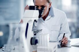 Scientist counting cells